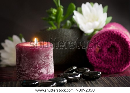 Spa setting  with massage stones and towel. - stock photo