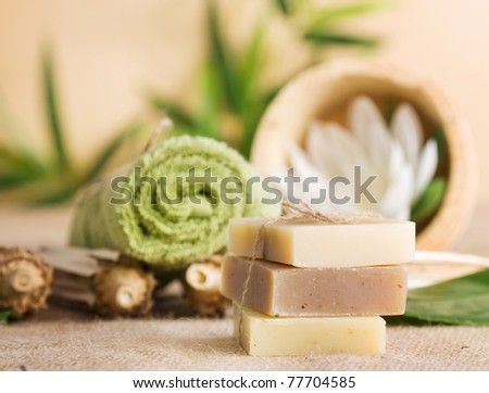 Spa setting with natural soaps and lotus flower. - stock photo