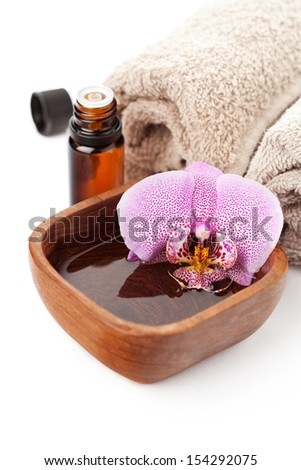 Spa setting with orchid on white background - stock photo