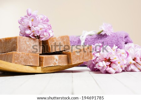 spa setting with pink flowers on white wood