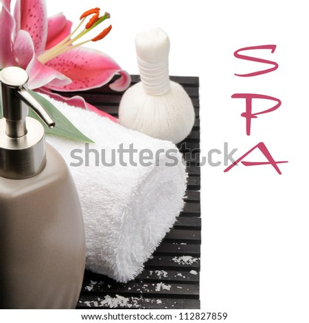 Spa setting with pink lily isolated on white - stock photo