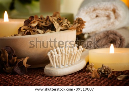 Spa setting with potpourri and candles - stock photo