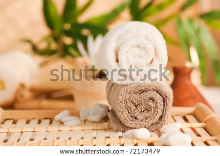 Spa setting with two towels and pebbles - stock photo