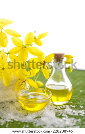 Spa setting with yellow orchid ,oil, pile of salt - stock photo