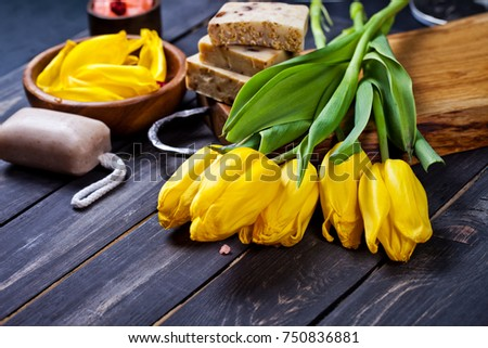Spa Setting with yellow tulips on dark wooden background