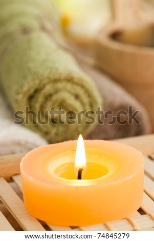 Spa setting withcandles, waterlily and pebbles - stock photo