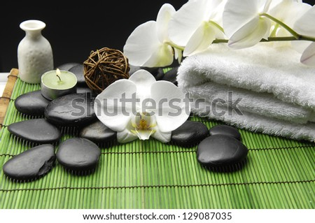 Spa Settings on green thin bamboo mat - stock photo