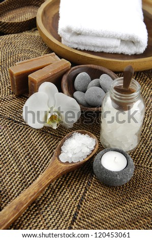 Spa Settings on straw mat background