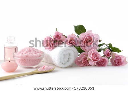 Spa sitting with rose ,salt in spoon, towel - stock photo