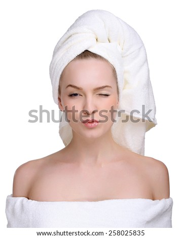 Spa skin care beauty woman wearing hair towel after beauty treatment. Beautiful multiracial young woman with perfect skin isolated on white background. - stock photo