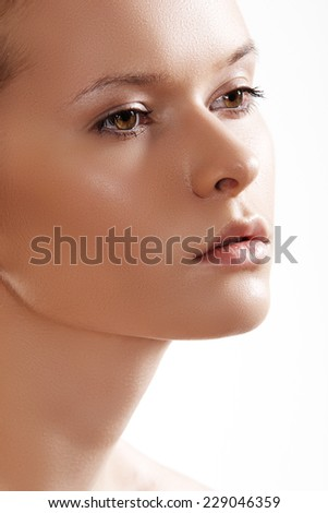 Spa, skincare, wellness & health. Close-up portrait of beautiful female model face with purity health skin & light make-up on white background.  - stock photo