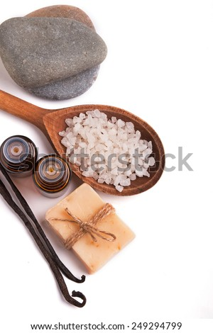 Spa still life. Aroma oils, stones, soap, sea salt and vanilla pods isolated on white background