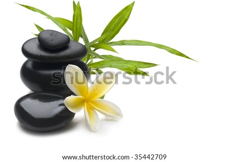 Spa still life background, with flower, bamboo and massage stones - stock photo