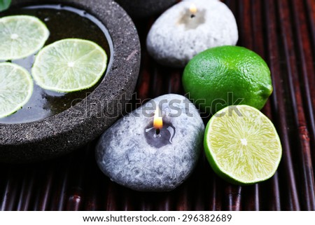 Spa still life in green color on bamboo mat, closeup - stock photo
