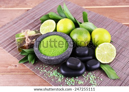 Spa still life on bamboo mat and wooden table background - stock photo