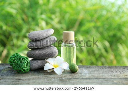 Spa still life on wooden surface over green reeds on river - stock photo