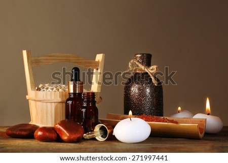 Spa still life on wooden table on brown background - stock photo