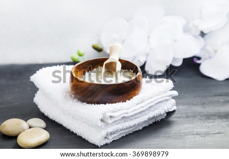 Spa still life setting with spa stones,bath salt and white towels - stock photo