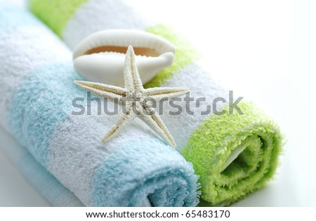 Spa still life. Shells on towels. - stock photo