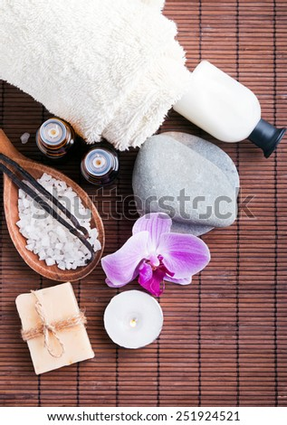 Spa still life with aroma oils , hand made soap and vanilla pods. Top view.