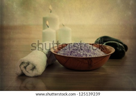 SPA still life with aromatic burning candles, stones, towel and lavender bath salt - stock photo