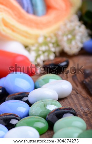 Spa still life with aromatic candles, stones, flower and towel, close up - stock photo