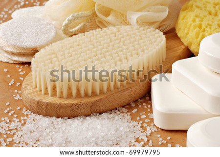 Spa still life with bamboo bath brush and natural vegetable oil soap.  Macro with shallow dof. - stock photo