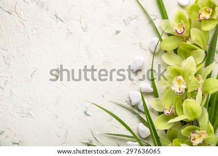 Spa still life with blooming orchid and pebbles. - stock photo