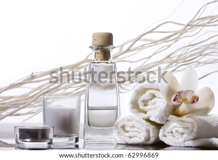 Spa still life with bottle of herbal essenses. - stock photo