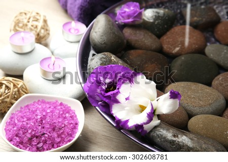 Spa still life with bowl of water for pedicure procedure - stock photo