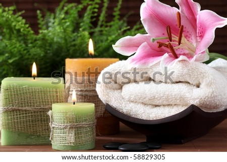 Spa still life with candles and towel - stock photo