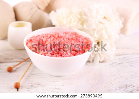 Spa still life with color sea salt on wooden table, closeup - stock photo