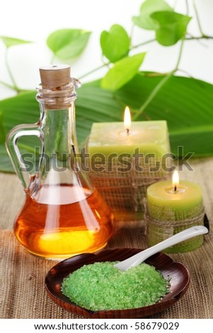 Spa still life with essential oil,candles and bath-salt - stock photo