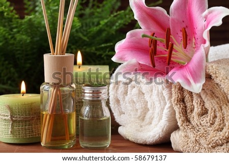Spa still life with essential oil,candles and towel - stock photo