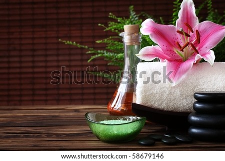 Spa still life with essential oil,stones and towel - stock photo
