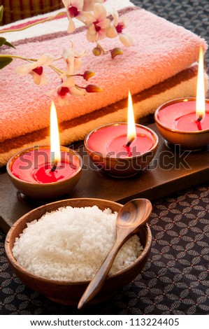 Spa still life with exfoliation salt scrub and spa accessories. - stock photo