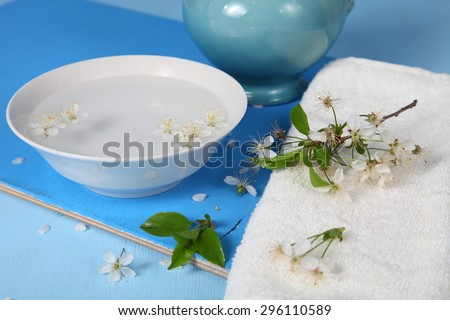 Spa still life with flowers of apple, water and towel