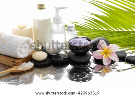 Spa still life with frangipani ,palm and black stone, candle - stock photo