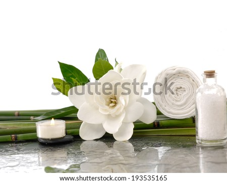 Spa still life with Gardenia ,candle ,salt in glass ,towel on bamboo grove  - stock photo