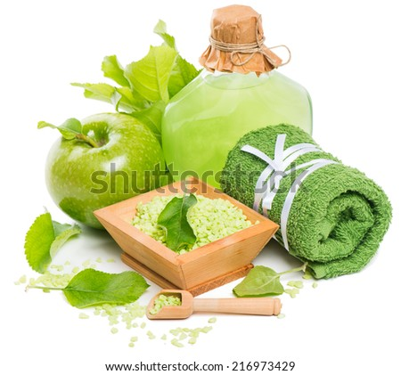 spa still-life with green apple, sea salt and moisturizer isolated on white - stock photo
