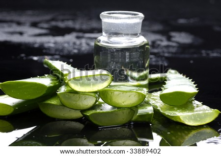 Spa still life with green leaf of aloe with lotion