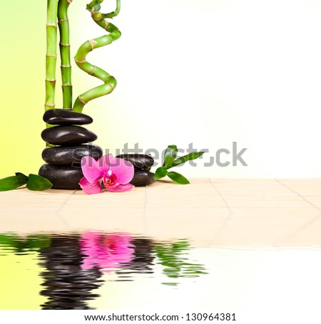 Spa still life with lava stones and bamboo sprouts with free space for text - stock photo