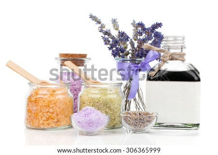 Spa still life with lavender flowers and bath salt, on white background - stock photo