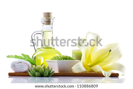 spa still-life with oil, sea salt, flowers and candles isolated on white - stock photo
