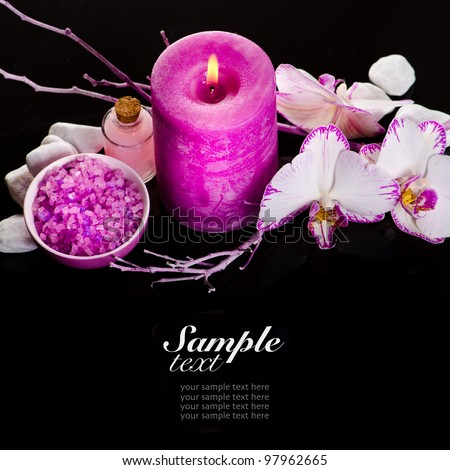 Spa still life with pink candle and orchids - stock photo