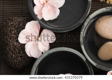 Spa still life, with pink flowers, stones and water - stock photo