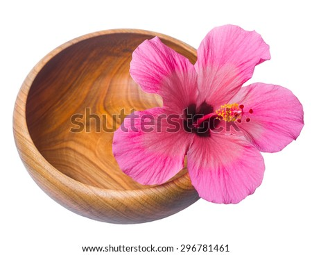 spa still life with pink hibiscus flower in wood bowl  - macro lens shot - stock photo