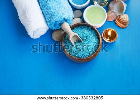Spa still life with sea salt ,towels ,scent candle and bath oil - stock photo