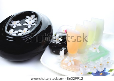 Spa still life with small white flowers - stock photo