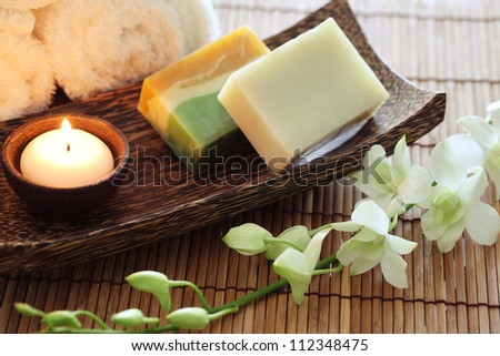 Spa still life with soap and candle - stock photo